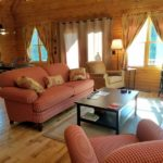 red check sofa at Shadyside Cabin