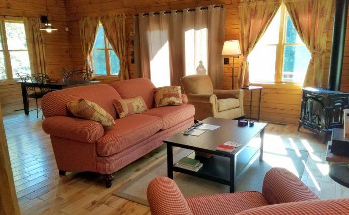 red check sofa at Shadyside Cabin